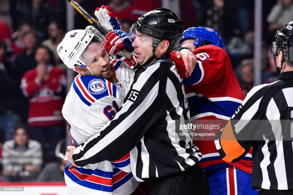 Linesman Pierre Racicot #65 tries to breakup a scuffle between Rick Nash #61 of the New York Rangers and Shea Weber #6 of the Montreal Canadiens in Game Five of the Eastern Conference First Round during the 2017 NHL Stanley Cup Playoffs at the Bell Centre on April 20, 2017 in Montreal, Quebec, Canada.