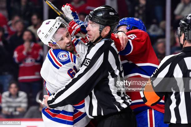Linesman Pierre Racicot tries to breakup a scuffle between Rick Nash of the New York Rangers and Shea Weber of the Montreal Canadiens in Game Five of...