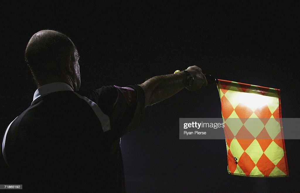 A linesman raises his flag during the Coca Cola Championship match between Luton Town and Colchester United at Kenilworth Road on September 12, 2006 in Luton, England.