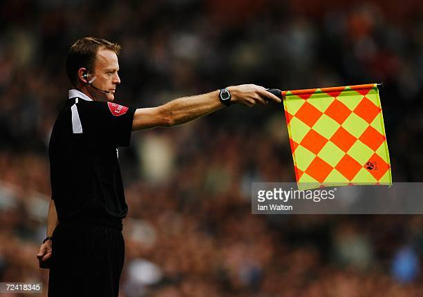 Linesman raises his flag for offside during the Barclays Premiership match between West Ham United and Arsenal at Upton Park on November 5, 2006 in...