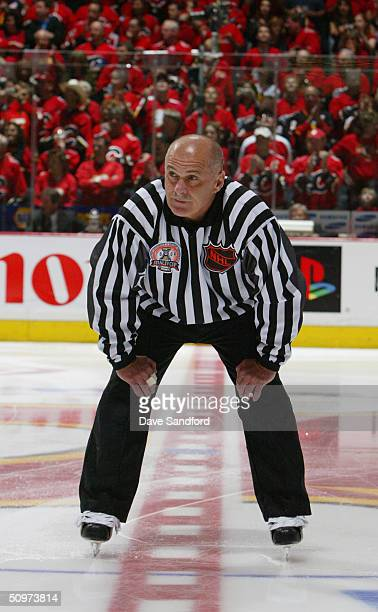 Linesman Ray Scapinello looks on from center ice in Game six of the NHL Stanley Cup Finals between the Tampa Bay Lightning and the Calgary Flames on...