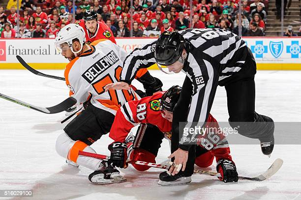 Linesman Ryan Galloway falls over Teuvo Teravainen of the Chicago Blackhawks and PierreEdouard Bellemare of the Philadelphia Flyers in the first...