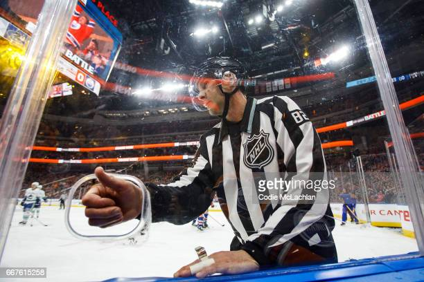 Linesman Ryan Galloway gives a thumbs up through the camera hole during a game between the Edmonton Oilers and the Vancouver Canucks on April 9 2017...