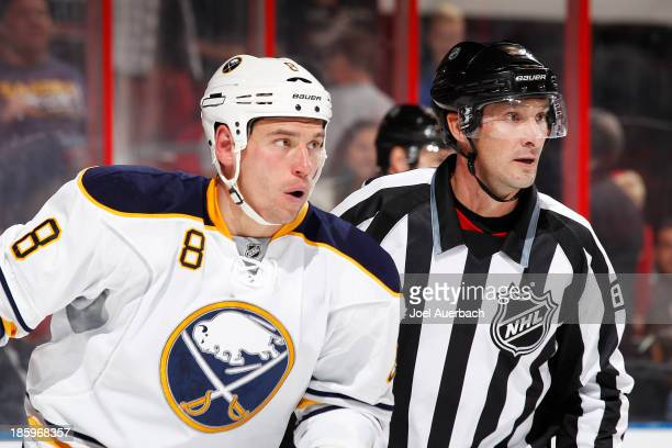 Linesman Ryan Galloway leads Cody McCormick of the Buffalo Sabres to the penalty box after his fight with Erik Gudbranson of the Florida Panthers at...