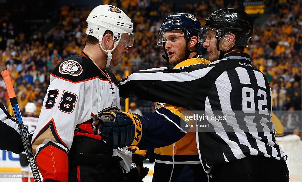 Linesman Ryan Galloway #82 separates Anthony Bitetto #2 of the Nashville Predators and Jamie McGinn #88 of the Anaheim Ducks after a whistle in Game Six of the Western Conference First Round during the 2016 NHL Stanley Cup Playoffs at Bridgestone Arena on April 25, 2016 in Nashville, Tennessee.