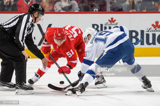Linesman Scott Cherrey drops the puck between Valtteri Filppula of the Detroit Red Wings and Barclay Goodrow of the Tampa Bay Lightning during an NHL...