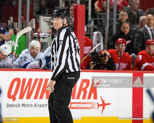Linesman Scott Driscoll follows the play during an NHL game between the Detroit Red Wings and the Tampa Bay Lightning at Little Caesars Arena on...