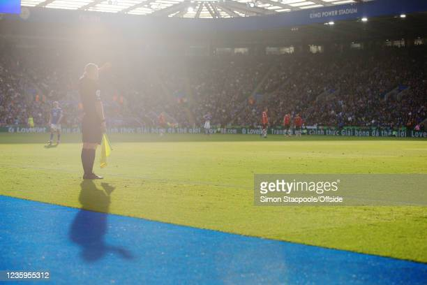 Linesman shield his eyes from the low sunlight during the Premier League match between Leicester City and Manchester United at The King Power Stadium...