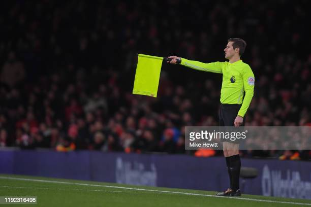 Linesman signals offdside during the Premier League match between Arsenal FC and Brighton & Hove Albion at Emirates Stadium on December 05, 2019 in...