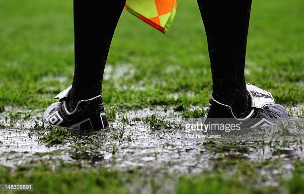 Linesman stands in a puddle during the Pre-Season Friendly match between Southend United and West Ham United at Roots Hall on July 14, 2012 in...