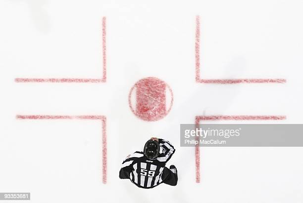 Linesman Steve Barton blows his whistle to call for a faceoff in a game between the Pittsburgh Penguins and the Ottawa Senators at Scotiabank Place...