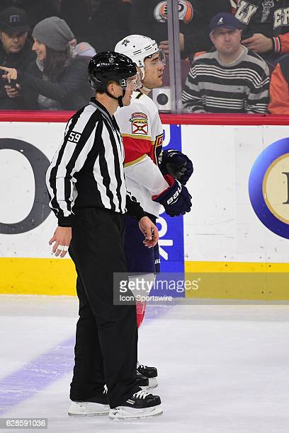 Linesman Steve Barton escorts Florida Panthers Left Wing Colton Sceviour to the penalty box during a National Hockey League game between the Florida...