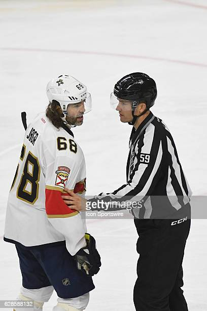 Linesman Steve Barton escorts Florida Panthers Right Wing Jaromir Jagr to the penalty box during a National Hockey League game between the Florida...