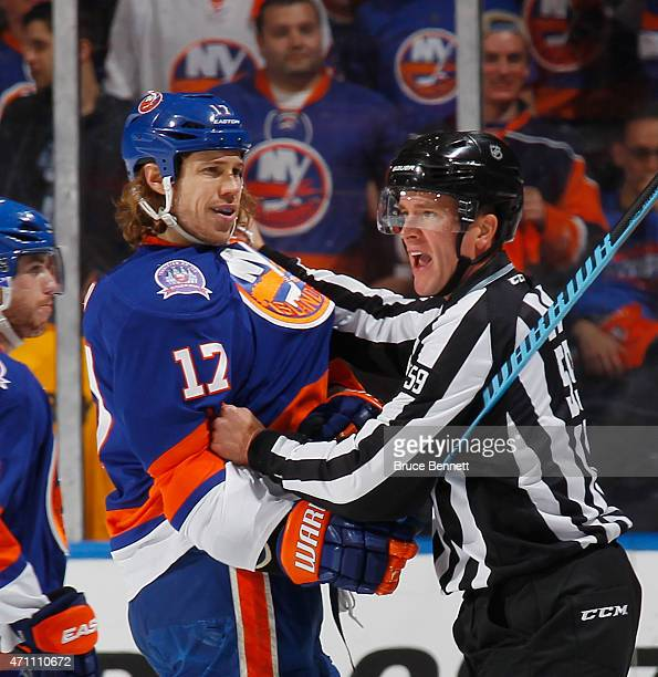 Linesman Steve Barton holds on to Matt Martin of the New York Islanders during the game against the Washington Capitals in Game Six of the Eastern...