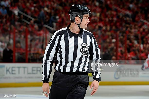 Linesman Steve Barton skates down the ice during the game between the New Jersey Devils and the Washington Capitals at the Verizon Center on October...