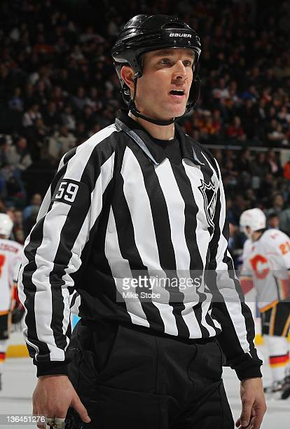 linesman Steve Barton skates during the game between the New York Islanders and the Calgary Flames at the Nassau Veterans Memorial Coliseum on...