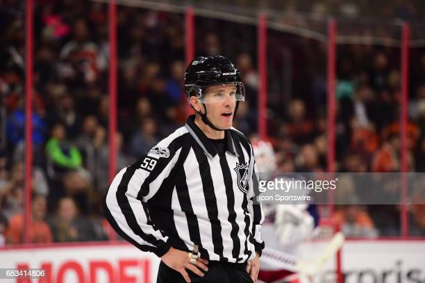 Linesman Steve Barton waits for play to begin during a National Hockey League game between the Columbus Blue Jackets and the Philadelphia Flyers on...