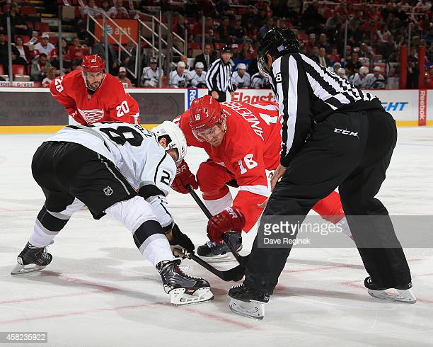 Linesman Steve Miller drops the puck for the faceoff between Jarret Stoll of the Los Angeles Kings and Joakim Andersson of the Detroit Red Wings...