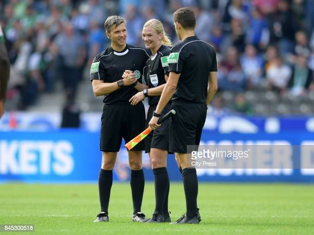 linesman Thomas Stein Match referee Bibiana Steinhaus and linesman Christof Guensch after the game between Hertha BSC and Werder Bremen on September...