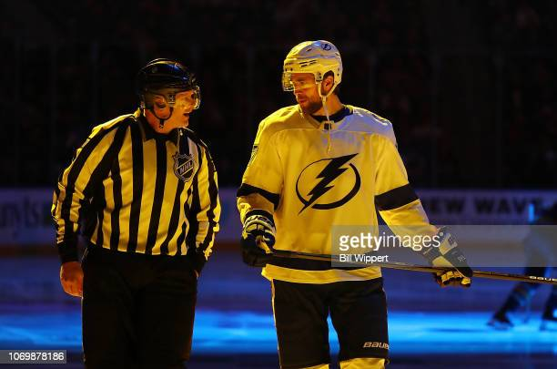 Linesman Tim Nowak chats with Victor Hedman of the Tampa Bay Lightning before during an NHL game against the Buffalo Sabres on November 13 2018 at...