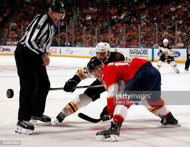 Linesman Tim Nowak drops the puck for a face off between Aleksander Barkov of the Florida Panthers and Patrice Bergeron of the Boston Bruins at the...