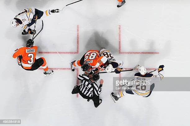 Linesman Tim Nowak gets out of the way following a faceoff between Claude Giroux and Radko Gudas of the Philadelphia Flyers and Zemgus Girensons Matt...