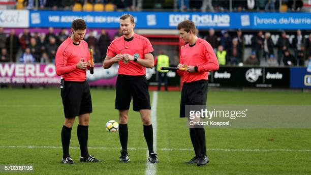 Linesman Tobias Schultes referee Florian Kornblum and linesman Andreas Hummel are seen during the 3 Liga match between SV Meppen and Chemnitzer FC at...