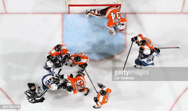 Linesman Tony Sericolo brakes up a scrum between Brandon Manning Nolan Patrick and Claude Giroux of the Philadelphia Flyers and Mathieu Perreault and...