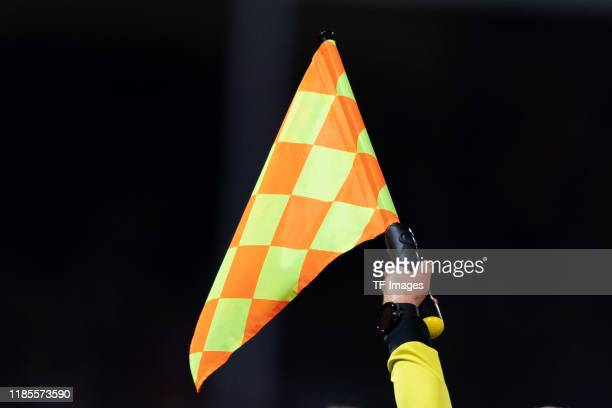 Linesman with flag are seen during the Second Bundesliga match between VfL Osnabrück and Hamburger SV at Stadion an der Bremer Brücke on November 29,...