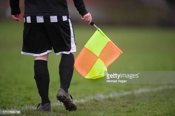 A linesman's flag during Sunday league football between Syston Brookside FC and Shepshed Oaks FC on March 15 2020 in Leicester England
