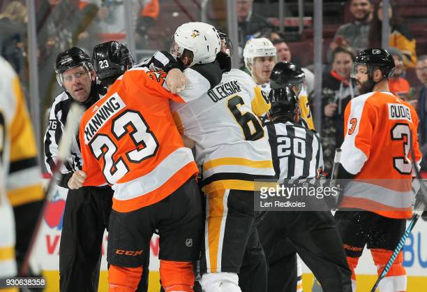 Linesmen Brian Mach and Michel Cormier separates Brandon Manning of the Philadelphia Flyers and Jamie Oleksiak of the Pittsburgh Penguins during a...