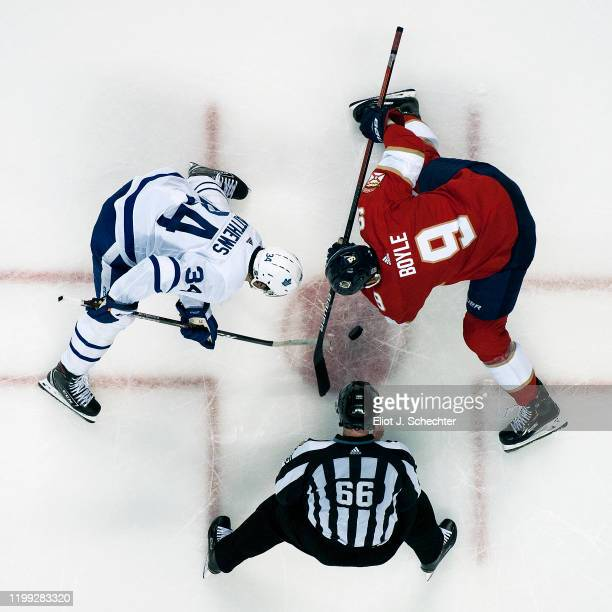 Linesmen Darren Gibbs drops the puck for a face off between Auston Matthews of the Toronto Maple Leafs and Brian Boyle of the Florida Panthers at the...