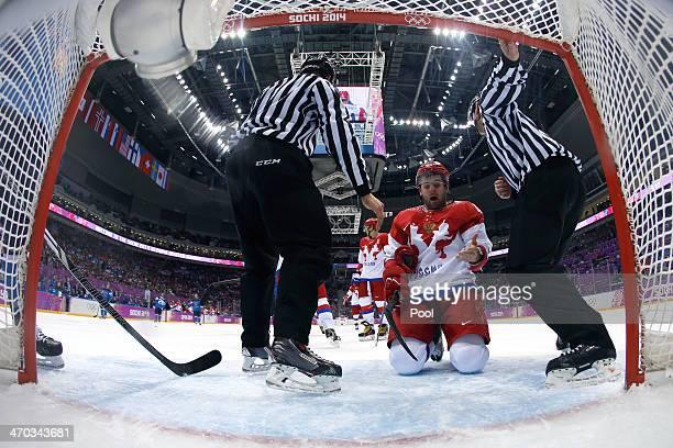 Linesmen intervene after Alexander Radulov of Russia slid into the net of Tuukka Rask of Finland during the Men's Ice Hockey Quarterfinal Playoff on...