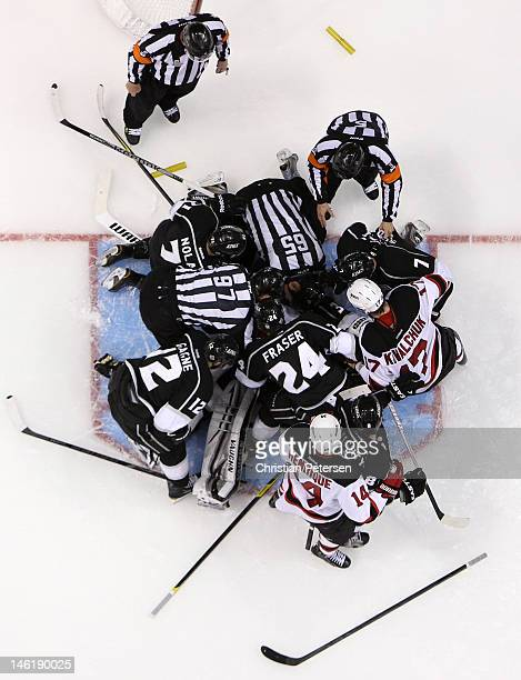 NHL linesmen Jean Morin and Pierre Racicot separate players from the the New Jersey Devils and the Los Angeles Kings in a scrum after Ryan Carter of...