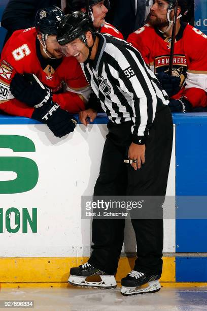 Linesmen Jonny Murray shares a laugh with Alex Petrovic of the Florida Panthers during a break in the action against the Philadelphia Flyers at the...