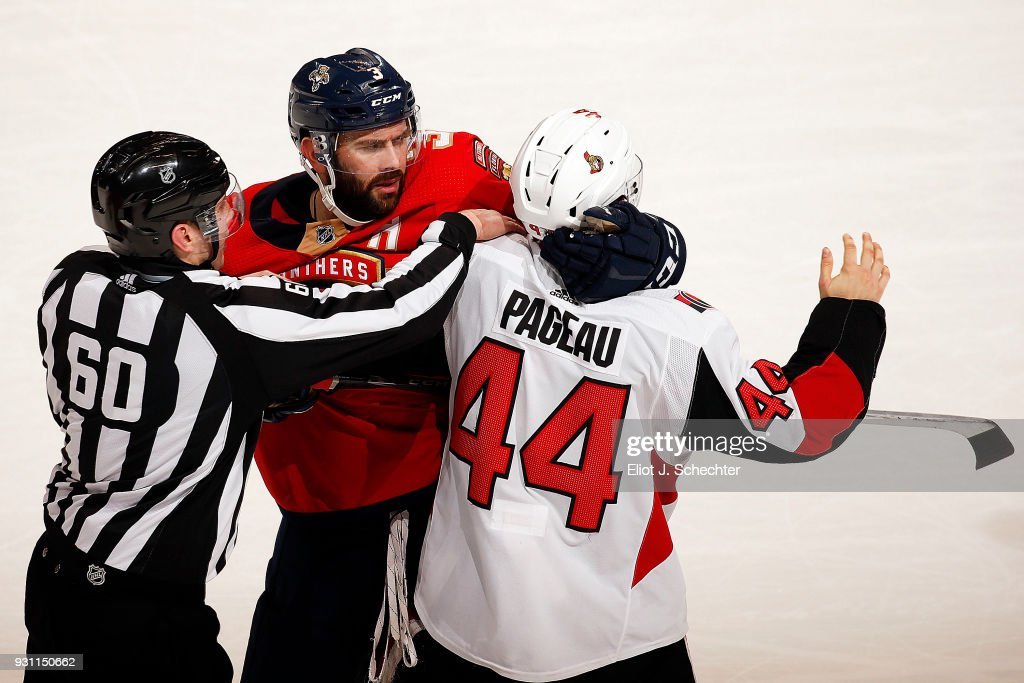 NHL Linesmen Libor Suchanek #60 separates Keith Yandle #3 of the Florida Panthers and Jean-Gabriel Pageau #44 of the Ottawa Senators during a altercation at the BB&T Center on March 12, 2018 in Sunrise, Florida.
