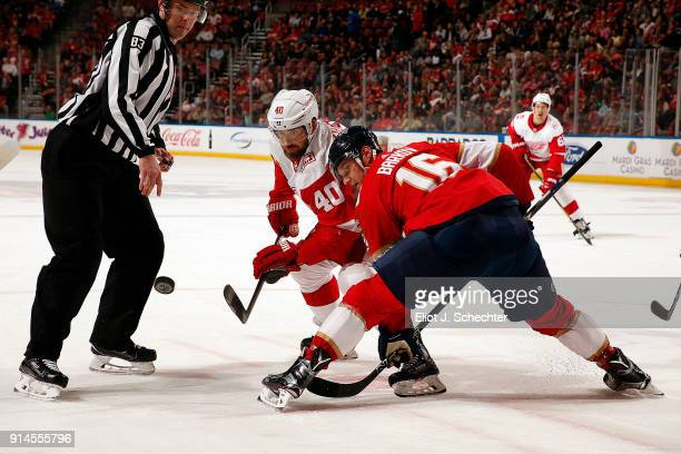 Linesmen Matt Macpherson drops the puck for a face off between Aleksander Barkov of the Florida Panthers and Henrik Zetterberg of the Detroit Red...