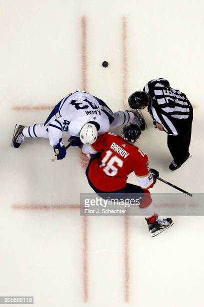 Linesmen Michel Cormier drops the puck for a face off between Nazem Kadri of the Toronto Maple Leafs and Aleksander Barkov of the Florida Panthers at...