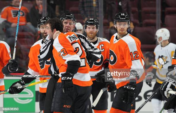 Linesmen Michel Cormier separates Brandon Manning of the Philadelphia Flyers during a scrum against the Pittsburgh Penguins with Radko Gudas Claude...