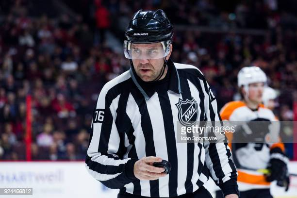 Linesmen Michel Cormier waits to drop puck for a faceoff during second period National Hockey League action between the Philadelphia Flyers and...