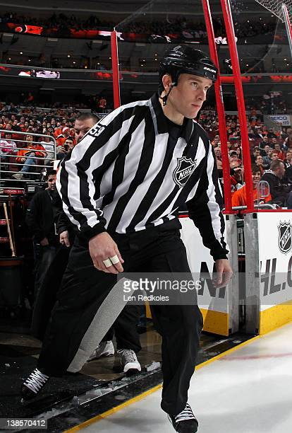 Linesmen Steve Barton skates onto the ice at the start of his game between the Philadelphia Flyers and the New York Islanders on February 7 2012 at...