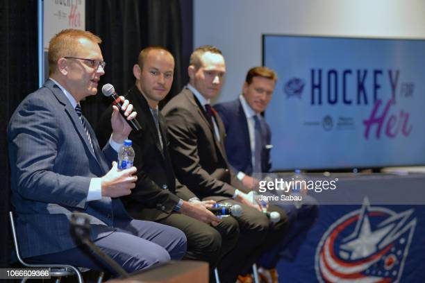 NHL linesmen Tim Nowak far left and Kory Nagy near left and NHL referees Graham Skilliter middle and Kelly Sutherland talk to a group of hockey fans...