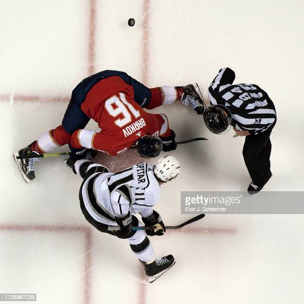 Linesmen Tony Sericolo drops the puck for a face off between Aleksander Barkov of the Florida Panthers and Anze Kopitar of the Los Angeles Kings at...