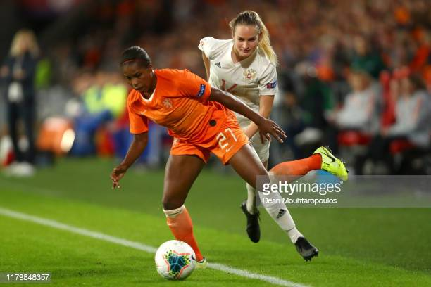 Lineth Beerensteyn of Netherlands battles for the ball with Kristina Mashkova of Russia during the UEFA Women's Euros 2021 Group A, qualifying match...