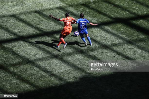 Lineth Beerensteyn of Netherlands is challenged by Valentina Bergamaschi of Italy during the 2019 FIFA Women's World Cup France Quarter Final match...