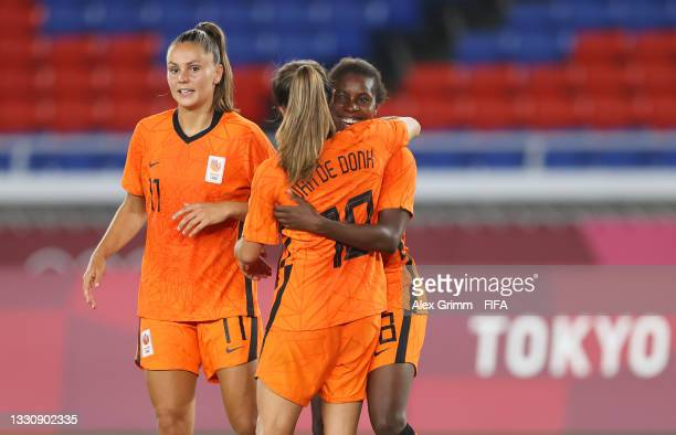 Lineth Beerensteyn of Team Netherlands celebrates with Lieke Martens and teammates after scoring their side's second goal during the Women's Group F...