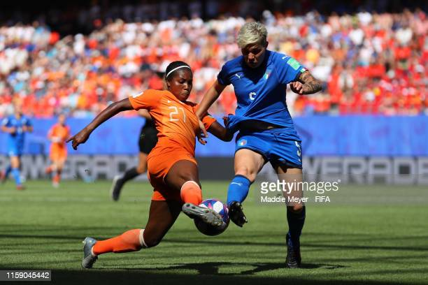 Lineth Beerensteyn of the Netherlands battles with Elena Linari of Italy during the 2019 FIFA Women's World Cup France Quarter Final match between...