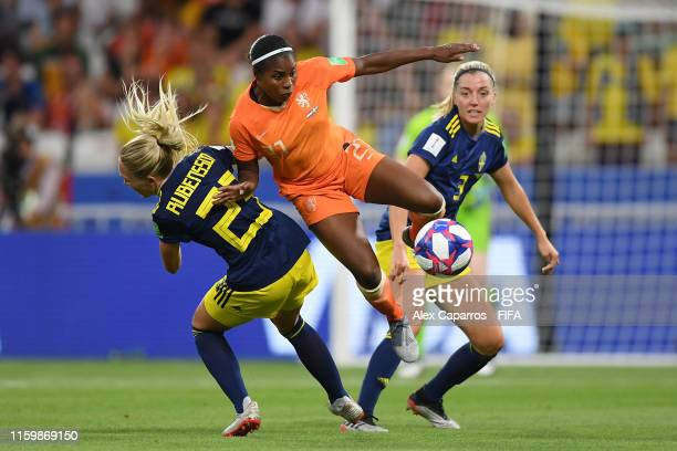 Lineth Beerensteyn of the Netherlands clashes with Elin Rubensson of Sweden during the 2019 FIFA Women's World Cup France Semi Final match between...