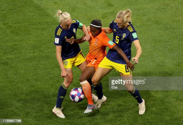 Lineth Beerensteyn of the Netherlands is challenged by Caroline Seger of Sweden and Magdalena Eriksson of Sweden during the 2019 FIFA Women's World...