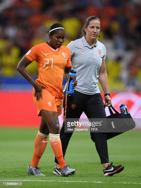 Lineth Beerensteyn of the Netherlands receives medical attention during the 2019 FIFA Women's World Cup France Semi Final match between Netherlands...